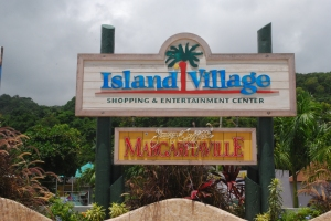 photo of island village sign in ocho rios