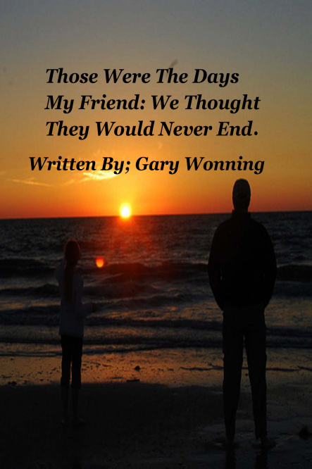 photo fo two people, a child and an adult looking at a sunset over the ocean